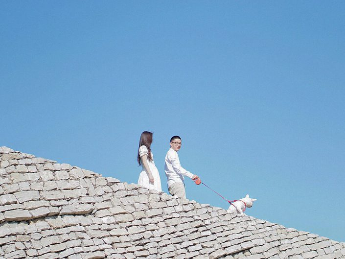 couple with dog and sky