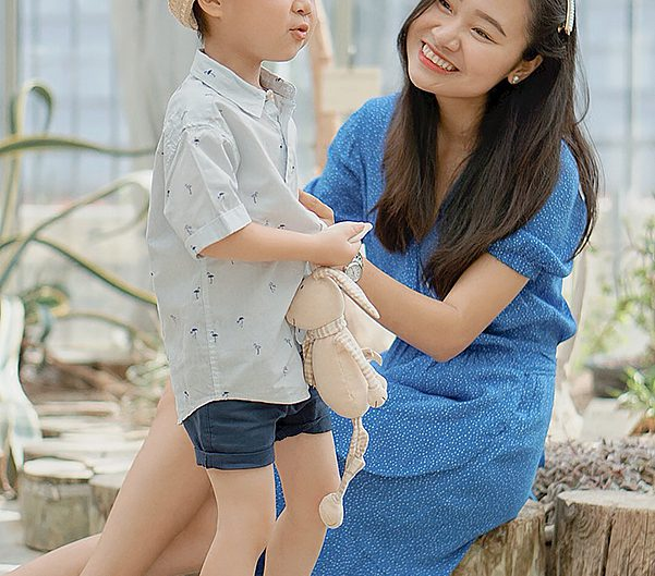 mom and son smilling together